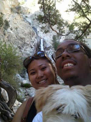 me, my boyfriend and our puppy snapping a shot with one of the tiers behind us